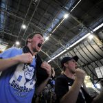 Kyle Faulker, left, and Gage Martin, both freshmen at Butler, react as they watch the closing seconds of Butler's 52-50 win against Michigan State during a watching party at Hinkle Fieldhouse in Indianapolis.