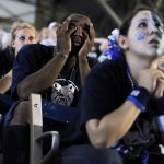 James Poscascio, a freshman at Butler, watches the action between his fingers during a viewing party of the Duke-Butler national championship game on Monday, April 5, 2010, at Hinkle Fieldhouse in Indianapolis.