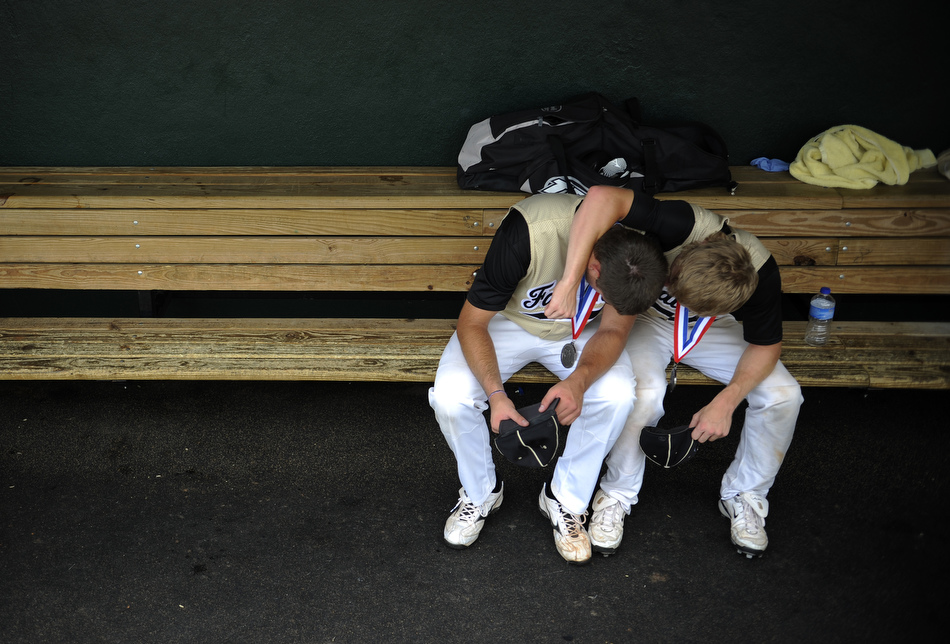 Bushland players Monty McCasland, left, and Thomas Cleveland share a moment in the dugout after a loss in the Class 2A state championship game at the University of Texas on Thursday, June 10, 2010.