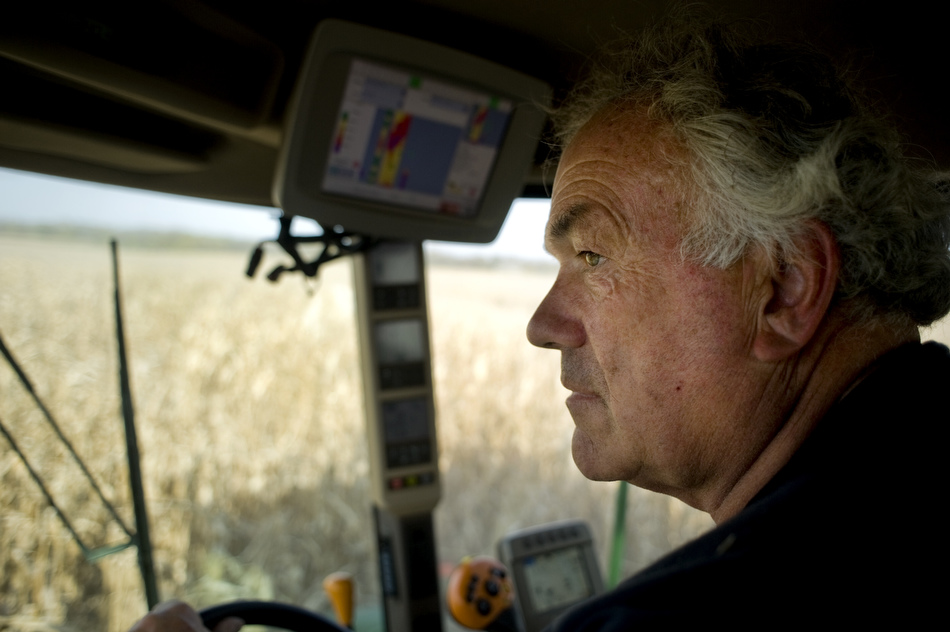 Mike Schachtrup watches out the windshield as he combines a field of corn on Monday, Oct. 11, 2010, near the intersection of Alta Lane and Radnor Road. Schachtrup farms about 6,000 acres in Peoria, Tazewell, Knox and Warren counties with his brothers including this 70-acre field northwest of Peoria.