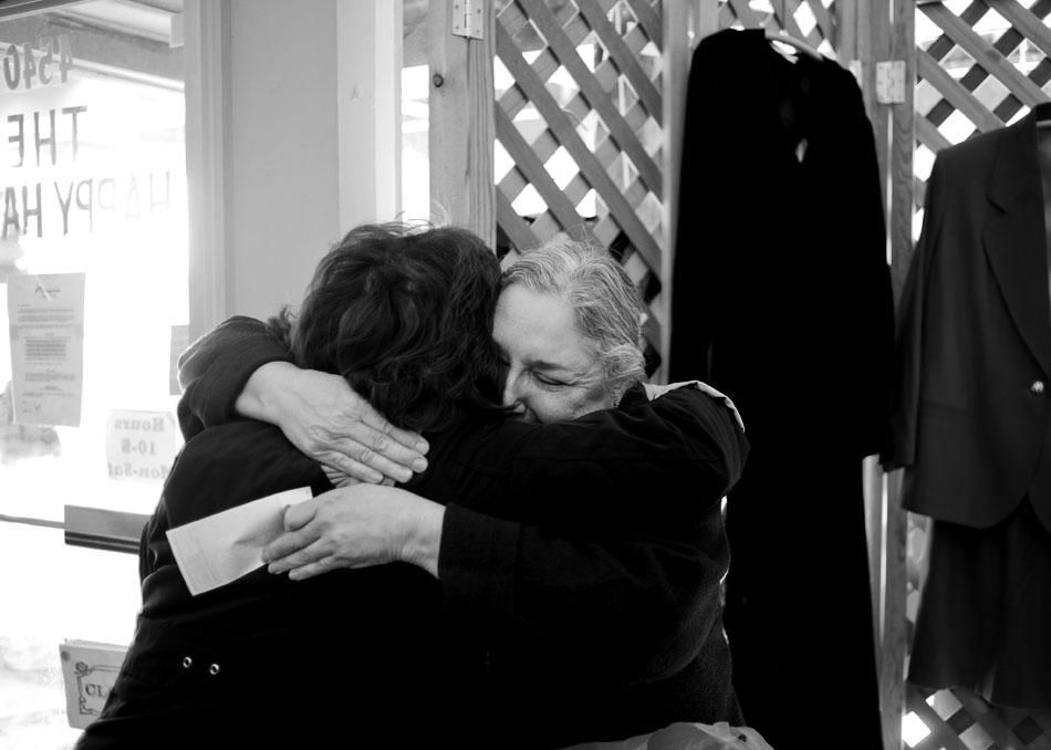 Sylvia Straw, owner of Happy Hanger, hugs Julie Polonus, a long-time patron, during a retirement sale on Friday, Dec. 17, 2010, at the store in Peoria Heights. Straw is closing the store after 30 years to retire. She says she's looking forward to painting and traveling in retirement.