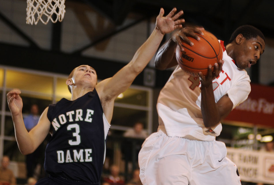 Glenbard East's Johnny Hill (44) grabs a rebound away from Notre Dame's Nate Bell (3) during the championship game in the State Farm Holiday Classic on Thursday, Dec. 30, 2010, in Bloomington, Ill.