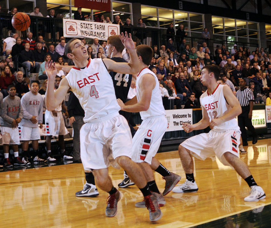 Glenbard East's Kevin Priebe (4) reacts as the ball flies through his hands during the championship game in the State Farm Holiday Classic on Thursday, Dec. 30, 2010, in Bloomington, Ill.