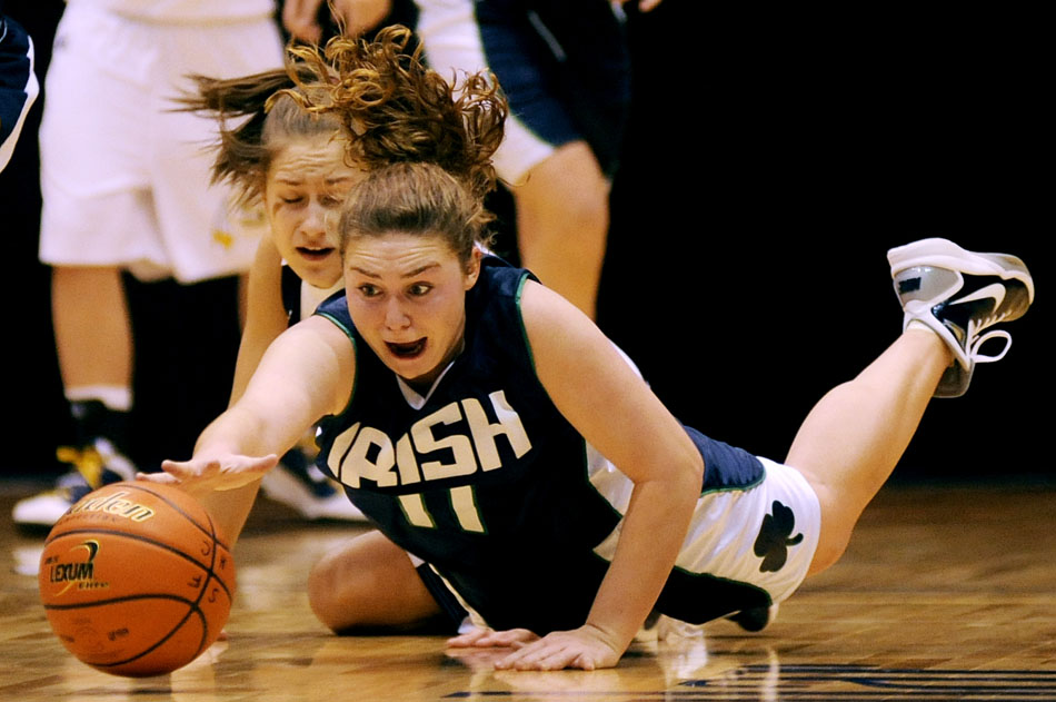Peoria Notre Dame's Katie Schuler dives after a loose ball during a game against Sterling in the State Farm Holiday Classic on Monday, Dec. 27, 2010, in Bloomington, Ill. Notre Dame won 52-44.