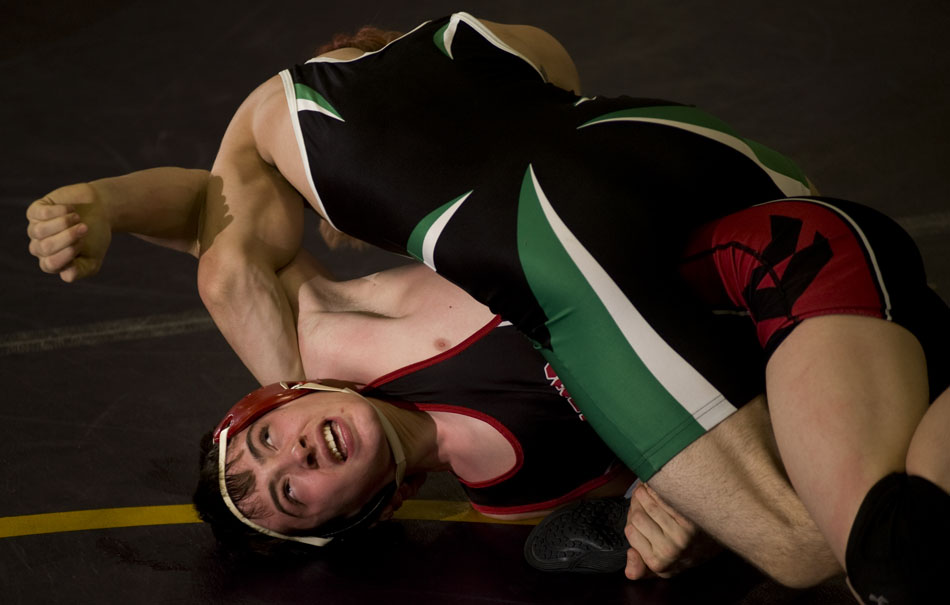 Springfield's Kris Kramer reacts as he fights off a pin from Eureka's Chris Griffieth during a tournament on Saturday, Dec. 4, 2010, at Notre Dame High School.