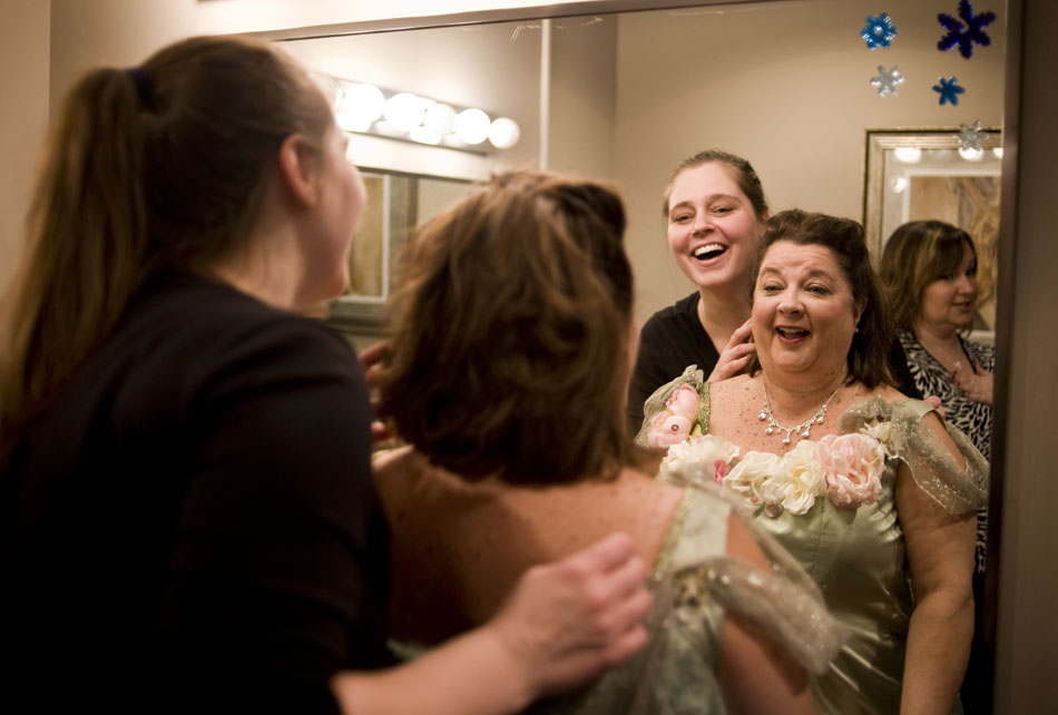 Malinda Martin, left, shares a laugh with Renee Spenny as Martin makes a few adjustments to Spenny's hair before her walk on role in the Peoria Ballet's performance of the Nutcracker on Sunday, Dec. 12, 2010, at the Civic Center.