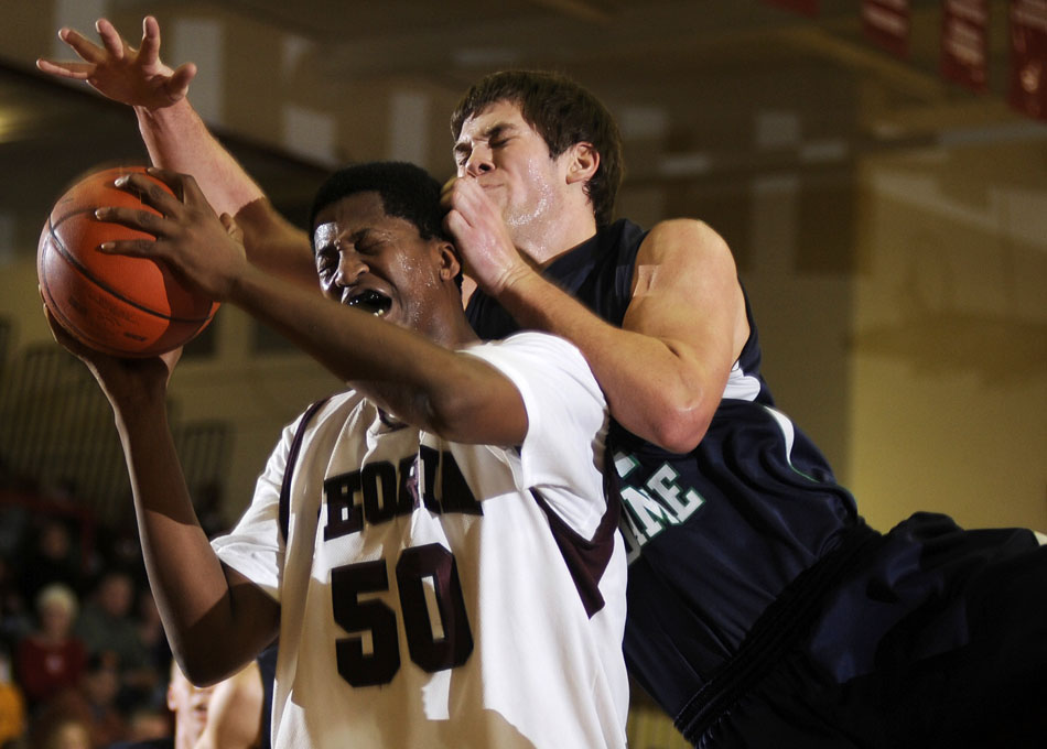Notre Dame's Drew Blumenshine fouls Central's Kevin Jordan (50) during a game on Friday, Dec. 17, 2010, at Peoria High School.