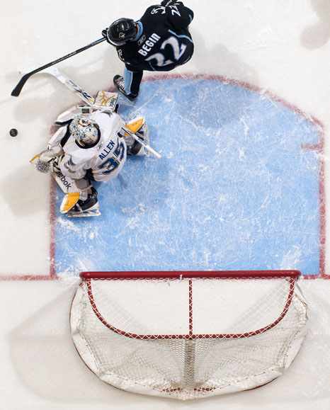 Milwaukee Admirals center Steve Begin (22) plays the puck near Peoria Rivermen goalie Jake Allen (35) during a game on Sunday, Dec. 5, 2010, at Carver Arena. The Rivermen lost in overtime after erasing an 4-1 deficit to force the extra period.