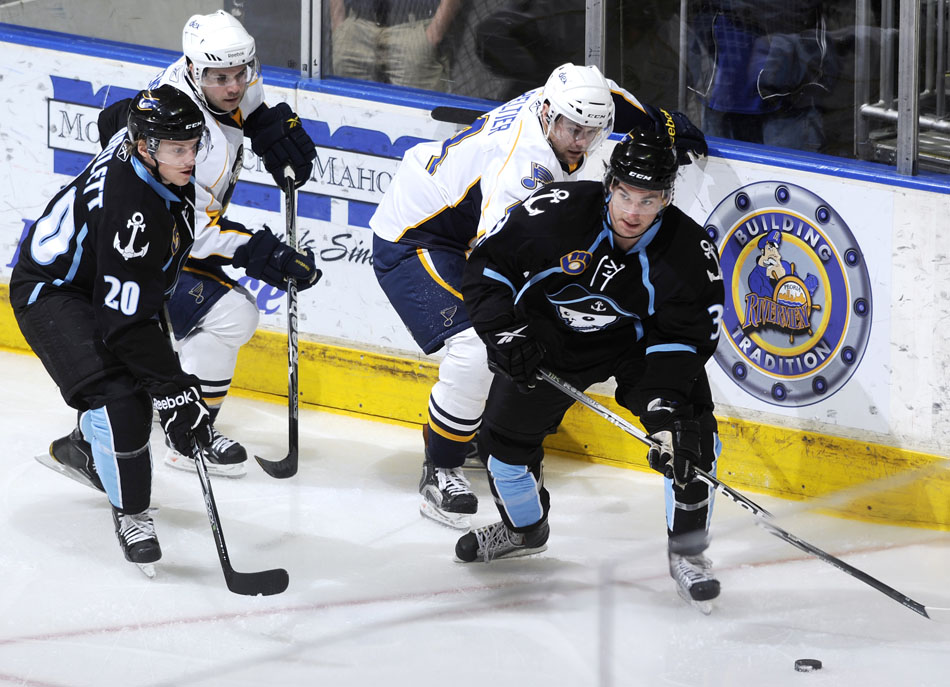 Milwaukee Admirals defender Roman Josi, right controls the puck during a game against Peoria on Friday, Dec. 31, 2010, at Carver Arena.