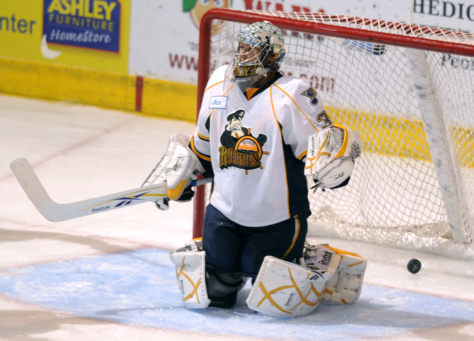 Peoria Rivermen goalie Jake Allen allows the puck to sneak by for a Milwaukee score during the second period of a game on Sunday, Dec. 5, 2010, at Carver Arena. Peoria lost 5-4 in overtime.