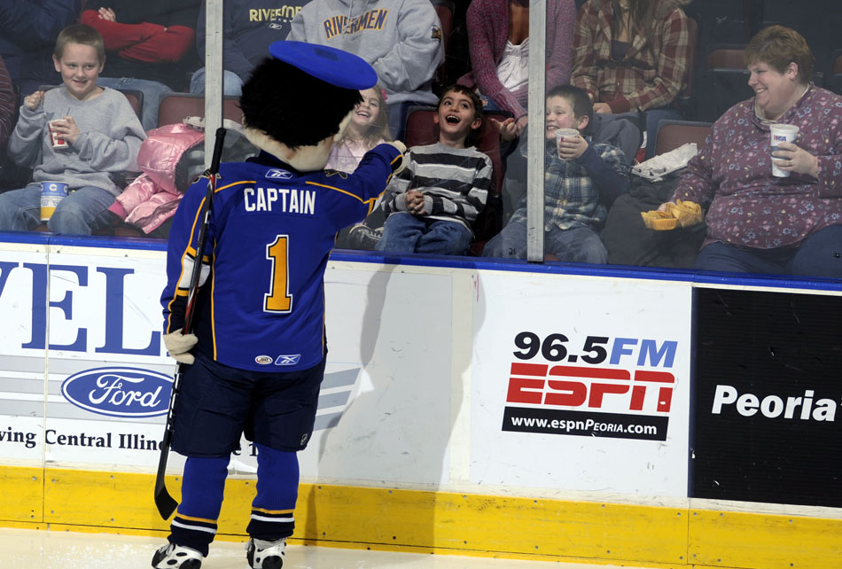 The Captain interacts with a fan through the glass before a game against Milwaukee on Sunday, Dec. 5, 2010, at Carver Arena.