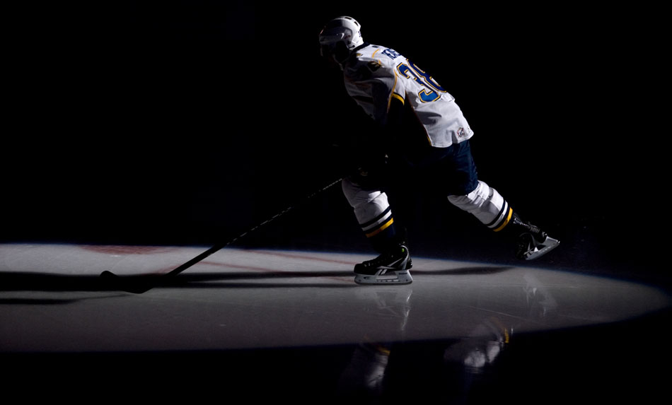 Peoria Rivermen right wing Ryan Reaves skates onto the ice as he is introduced in the starting lineup before a game against Milwaukee on Sunday, Dec. 5, 2010, at Carver Arena.