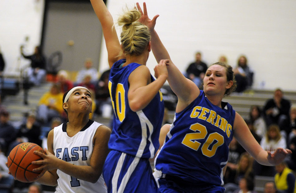 East's Lexi Hawkins (1) puts up a shot in front of Gering's Bryana Larsen and Jordan Plummer (20) during a game on Thursday, Jan. 13, 2011, at East.