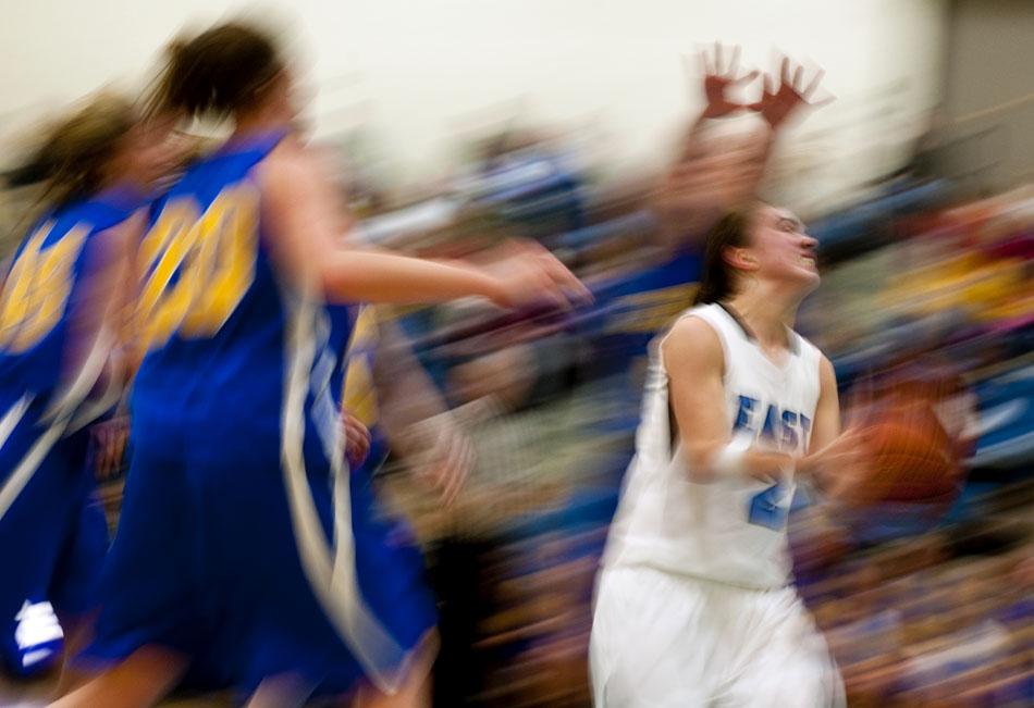 East's Savannah Minder drives to the basket and puts up a shot during a game against Gering on Thursday, Jan. 13, 2011, at East.