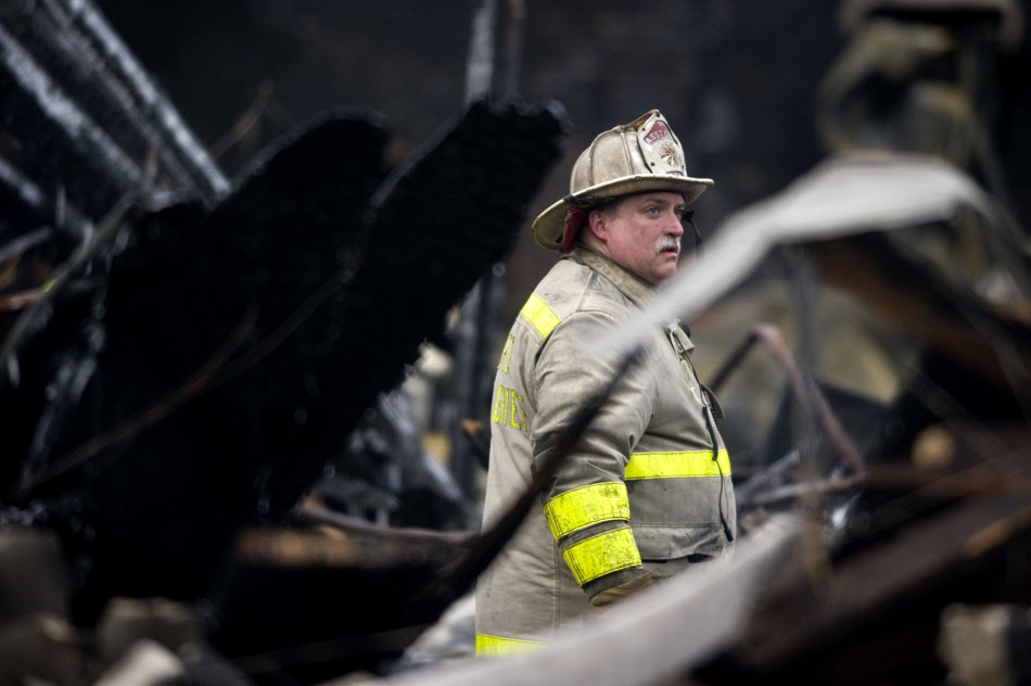 A West Peoria firefighter surveys the scene of a fire on Saturday, Jan. 1, 2011, at the Haddad's Supermarket in West Peoria. A blaze destroyed the building late Friday evening.