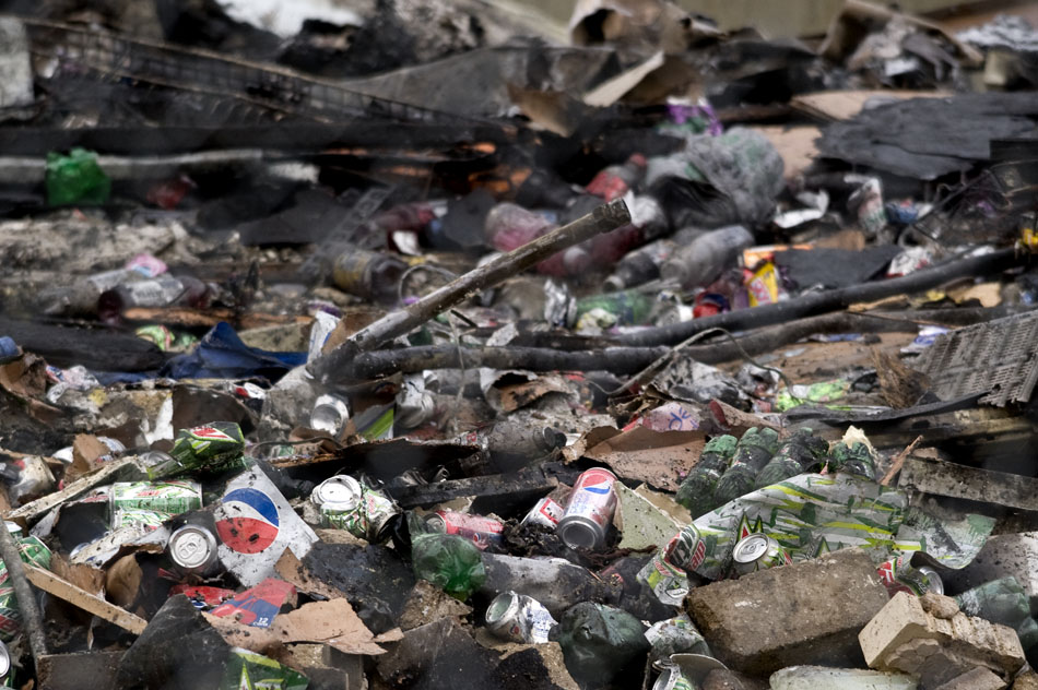 Cans of soda are seen among the rubble on Saturday, Jan. 1, 2011, at the site of the Haddad's Supermarket in West Peoria.