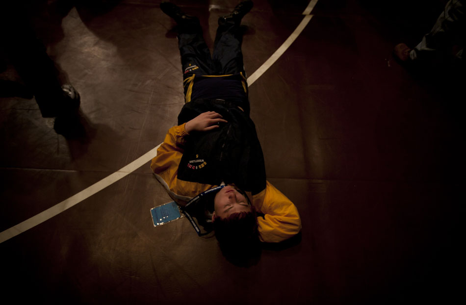 Greybull wrestler Nathen Gossens takes a nap during the March of Champions at the Wyoming state wrestling finals on Friday, Feb. 25, 2011, in Casper, Wyo.