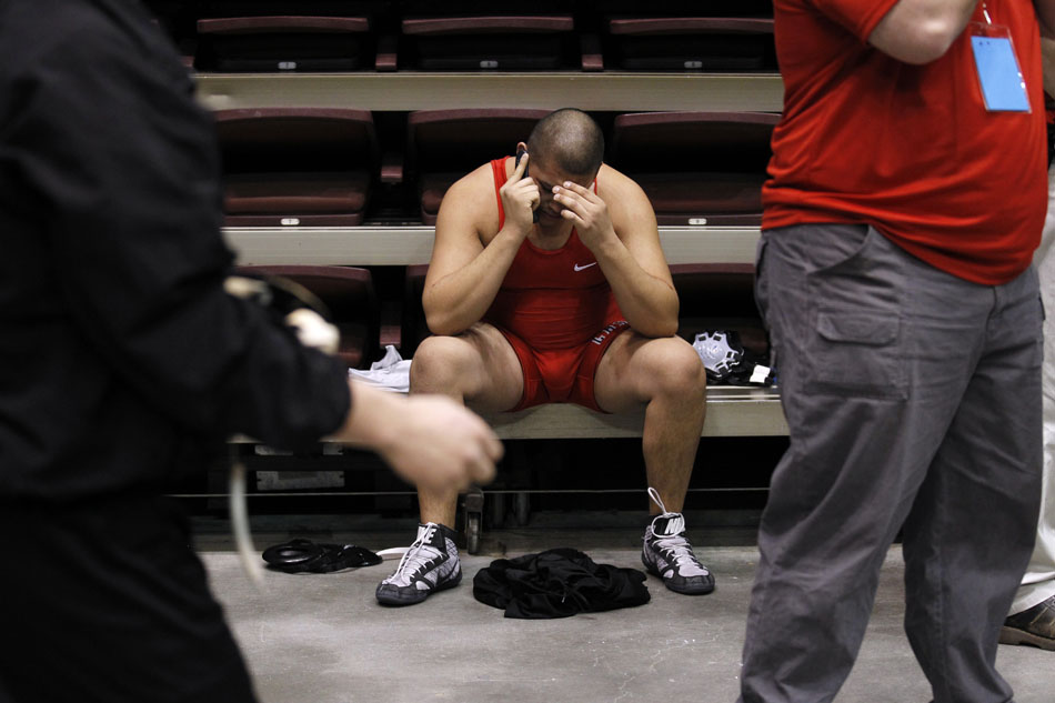Cheyenne Central's Leon Romero talks on the phone after a loss to Natrona County's Greg Lensert in a Class 4A 215-pound wrestleback match during the Wyoming high school state wrestling tournament on Saturday, Feb. 26, 2011, in Casper, Wyo.