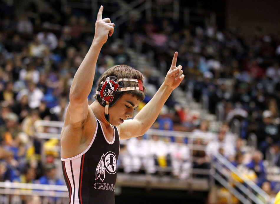 Cheyenne Central's Bryce Meredith celebrates a win against Star Valley's Mitch Heap during the 103 pound Class 4A championship match on Saturday, Feb. 26, 2011, in Casper, Wyo.