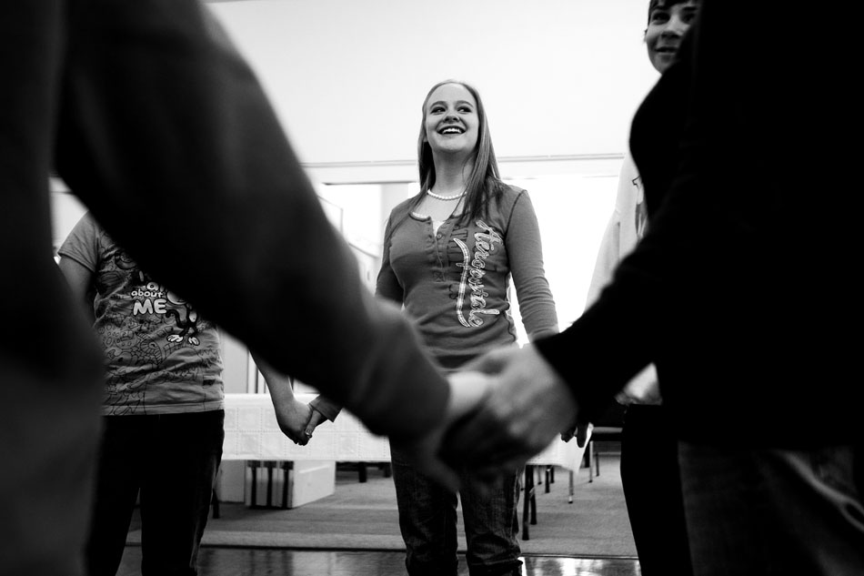Nathalia Rap, age 16, holds hands with her peers as she takes part in a traditional Jewish dance during Hebrew School on Sunday, Feb. 27, 2011, at the Mount Sinai Congregation in Cheyenne.