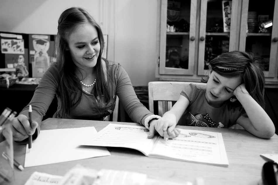 Nathalia Rap, age 16, helps Zoey Brown, age 5, sound out a letter in Hebrew on Sunday, Feb. 27, 2011, at the Mount Sinai Congregation in Cheyenne.