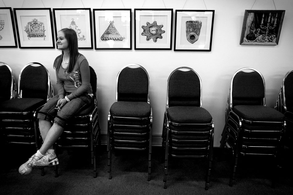 Nathalia Rap, age 16, takes a break on a stack of chairs after a Hebrew School lesson Sunday, Feb. 27, 2011, at the Mount Sinai Congregation in Cheyenne. The class included prayers, a meal and dancing.