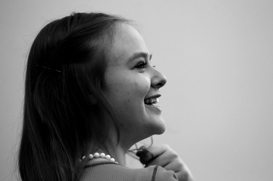 Nathalia Rap, age 16, shares a laugh as she listens to Rabbi Harley Kraz-Wagman, not pictured, explain a traditional Jewish prayer on Sunday, Feb. 27, 2011, at the Mount Sinai Congregation in Cheyenne.