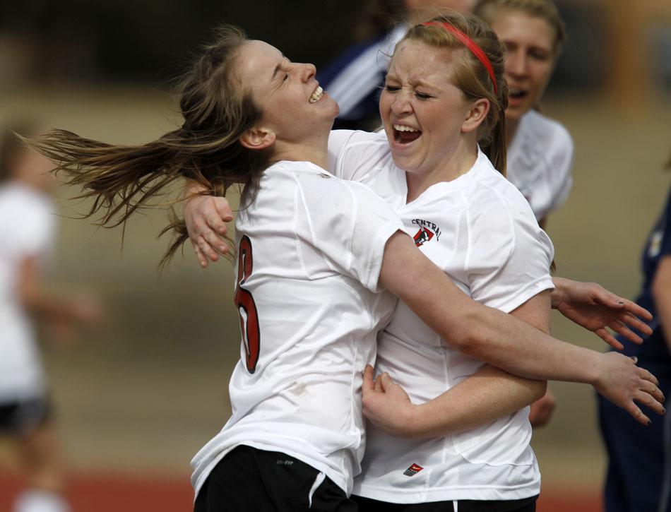 Cheyenne Central's Cori Bagby, left, celebrates with teammate Halee Moore after Bagby scored a goal during a high school girl's soccer game on Saturday, March 19, 2011, at Cheyenne Central High School. Palmer Ridge won 3-2 in overtime.