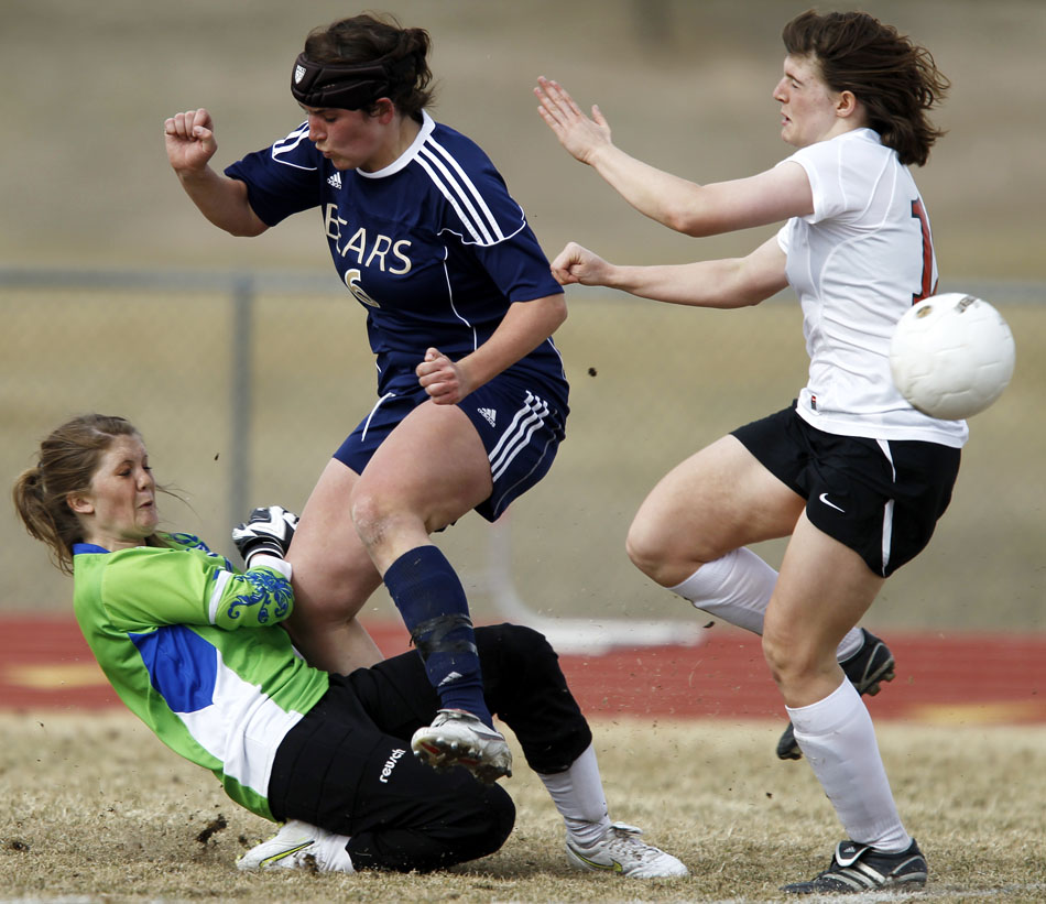Palmer Ridge's Haley Fisher (6) collides with Cheyenne Central keeper Kelly Fisher, bottom, during a high school girl's soccer game on Saturday, March 19, 2011, at Cheyenne Central High School. Palmer Ridge won 3-2 in overtime.