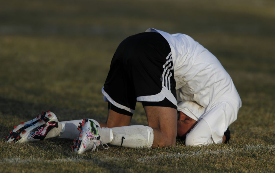 Cheyenne East's Alex Cowen falls to the pitch after missing a shot on goal in the final seconds of stoppage time that would have tied a game against Scottsbluff on Tuesday, March 22, 2011, at Cheyenne East High School. Scottsbluff won 1-0.