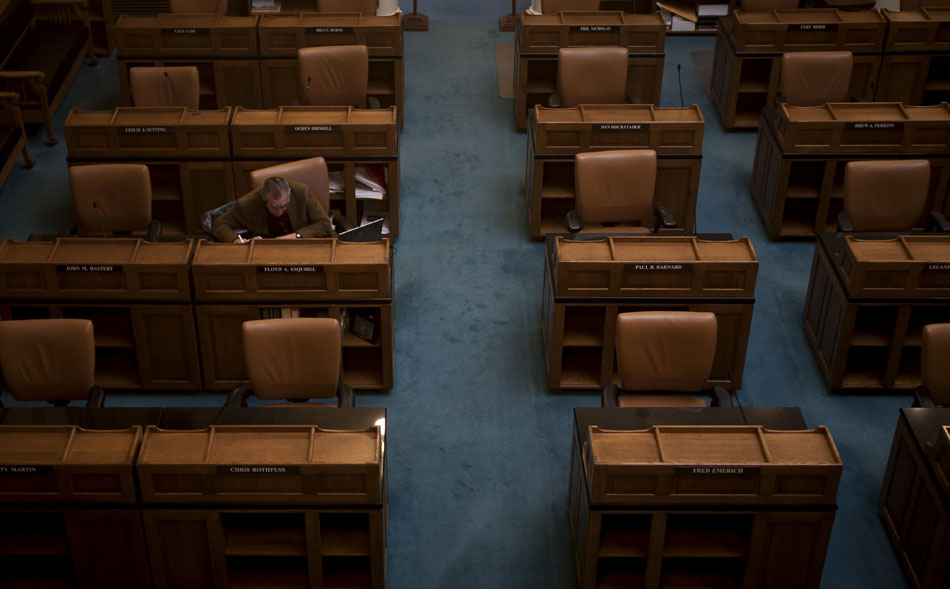 Sen. Floyd Esquibel, D-Cheyenne, works at his desk alone on Friday, March 25, 2011, in the Senate chambers at the Wyoming State Capitol in Cheyenne.