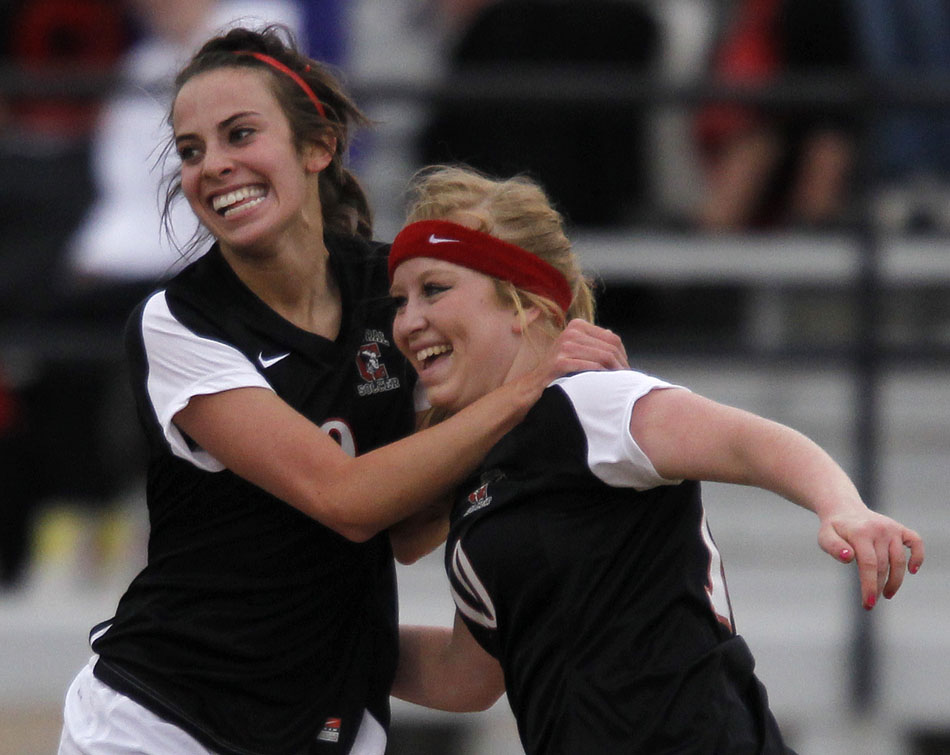 Cheyenne Central's Makena Cameron, left, celebrates with teammate Halee Moore after Cameron scored a goal during a high school girl's soccer game on Friday, March 25, 2011, at Cheyenne East High School.