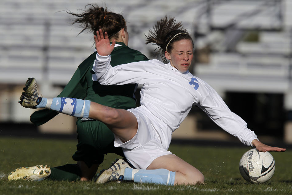 Cheyenne East's Rachel Erickson (6) reacts as she falls to the pitch after contact with Kelly Walsh defender Rachel Franke during a high school girl's soccer game on Tuesday, April 19, 2011, at Cheyenne East High School. Erickson connected on the free kick as East cruised to a 5-0 win.