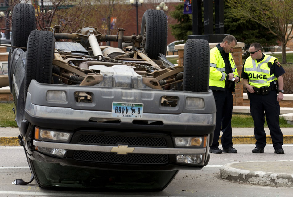 Cheyenne police investigate the scene of a rollover accident on Tuesday, April 19, 2011, in downtown Cheyenne. The truck rolled over and came to a rest on Central Avenue south of Lincolnway.