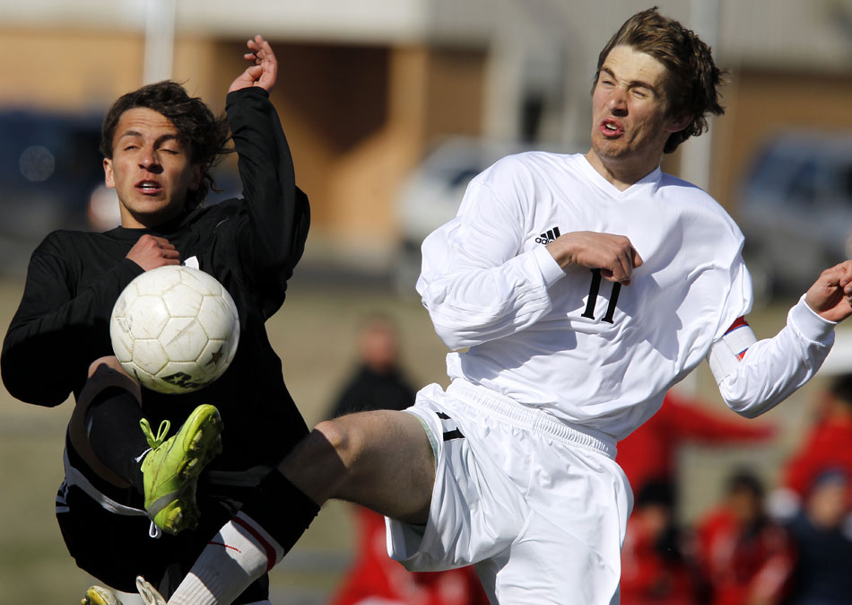 Cheyenne East's Blaine Shinn, left, and Cheyenne Central's Jay Egan-Wright (11) react as they fight for control of the ball during a high school boy's soccer game on Friday, April 29, 2011, at Cheyenne Central High School.