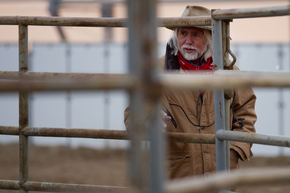 Erich Pröll, an Austrian filmmaker, watches a horse during a Bureau of Land Management auction on Saturday, April 30, 2011, at the Riata Ranch near Cheyenne. Pröll, who has produced documentaries for PBS, bought the first two horses up for auction. After buying the horses, Pröll will have to keep the horses in Wyoming for a year before he can gain the title for the animals. After a year, he hopes to bring the animals to a ranch he owns along the Danube River near the city of Linz, in northern Austria.