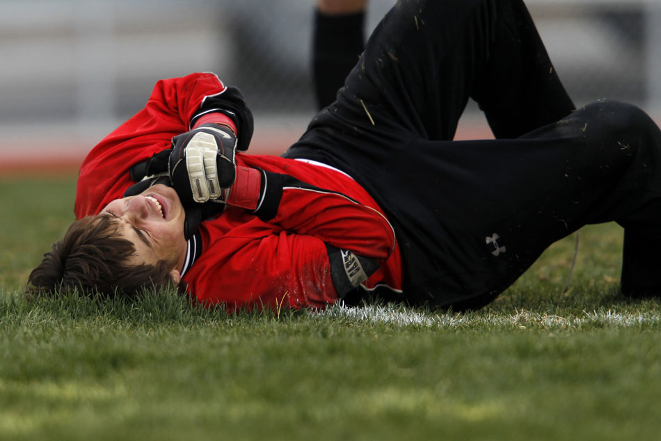 Gillette keeper Jordan Rueschoff holds his hand in pain after a collision with a Cheyenne East player during a boy's soccer regional game on Thursday, May 12, 2011, at Cheyenne South High School.