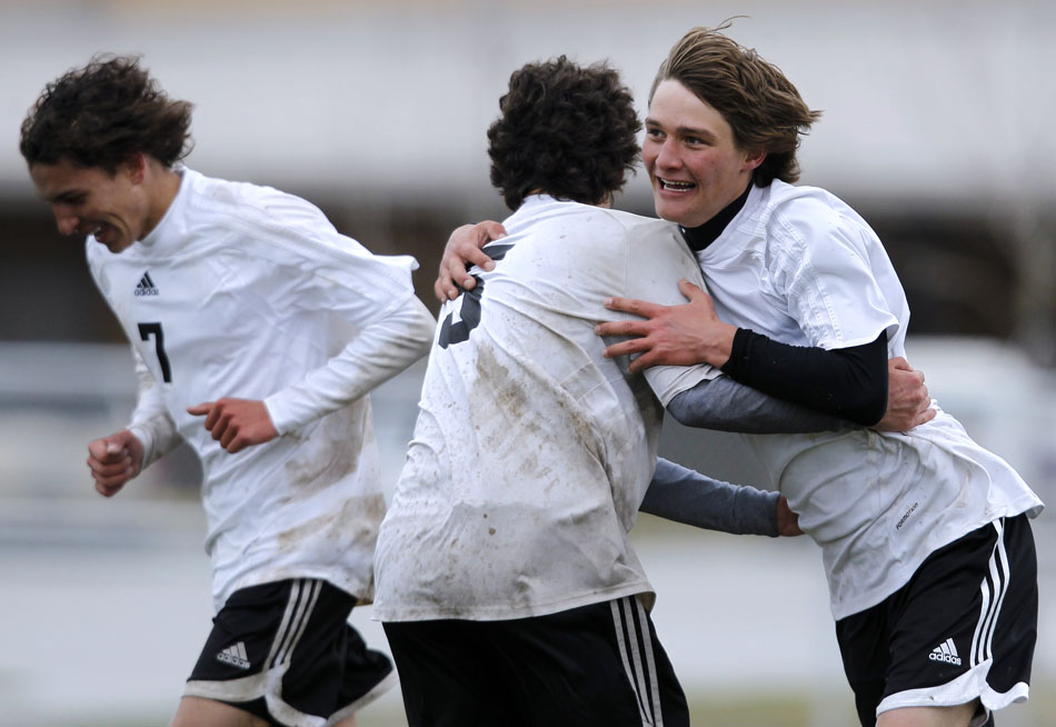 Cheyenne East's Clay Casey celebrates after scoring a goal with teammate Jalen Willett (5) during a boy's soccer regional game on Thursday, May 12, 2011, at Cheyenne South High School.