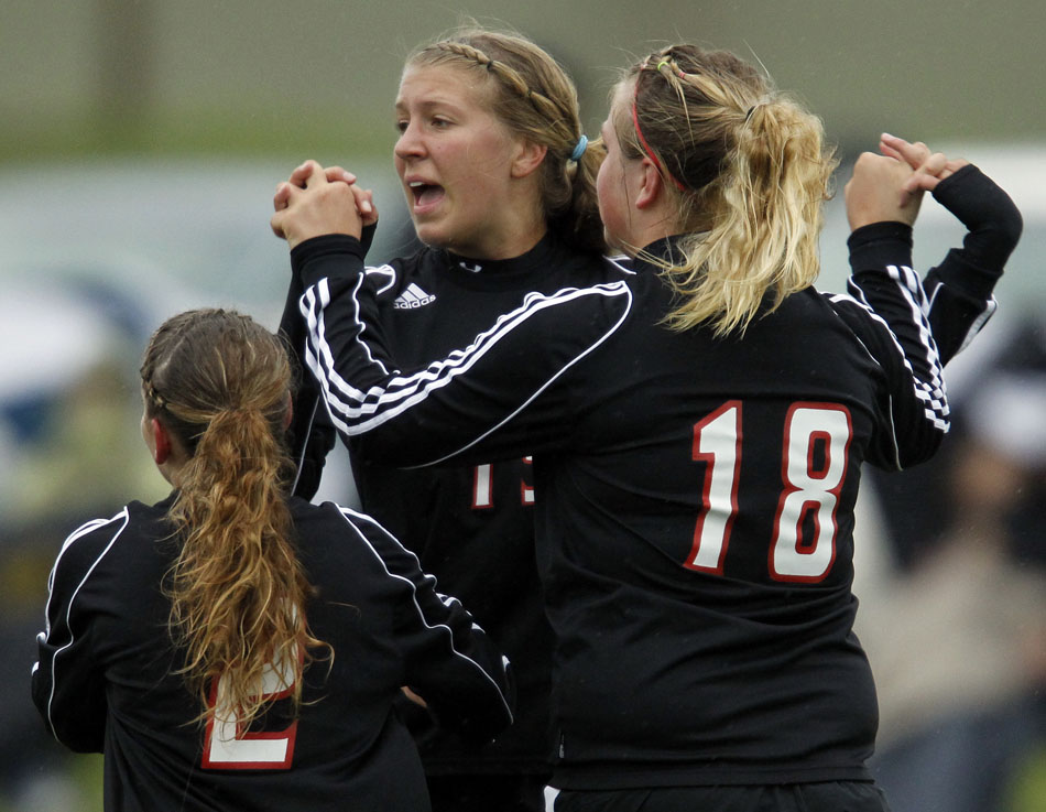 Cheyenne Central's Christie Schiel celebrates with teammates after a goal during a girl's state soccer quarterfinal on Thursday, May 19, 2011, in Sheridan, Wyo.
