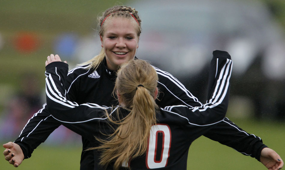 Cheyenne Central's Sierra Kuno celebrates with teammate Halee Moore after Kuno scored a goal during a girl's state soccer quarterfinal on Thursday, May 19, 2011, in Sheridan, Wyo. Central won 5-1.