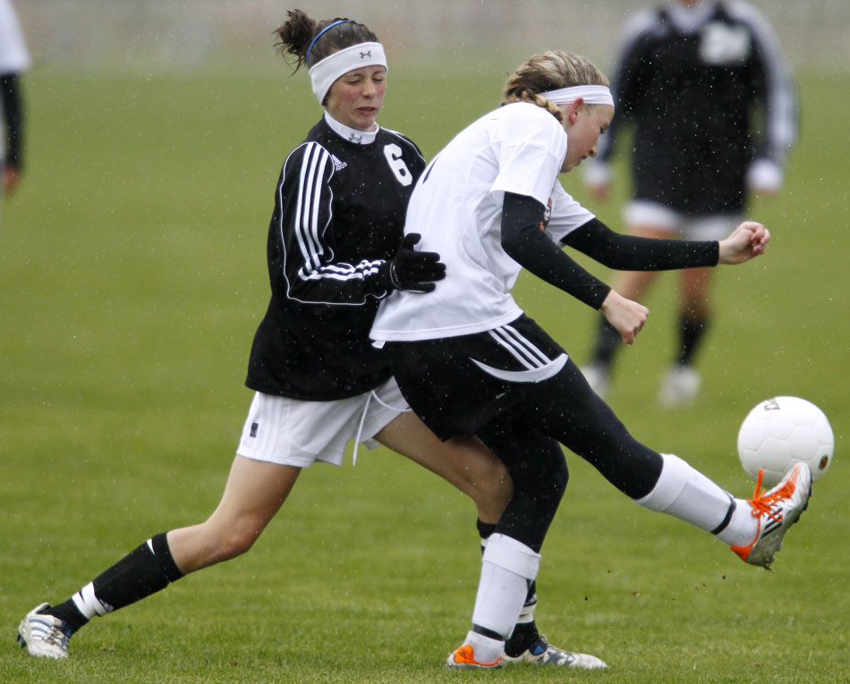 Cheyenne East's Rachel Erickson plays the ball during a girl's state soccer quarterfinal on Thursday, May 19, 2011, in Sheridan, Wyo.