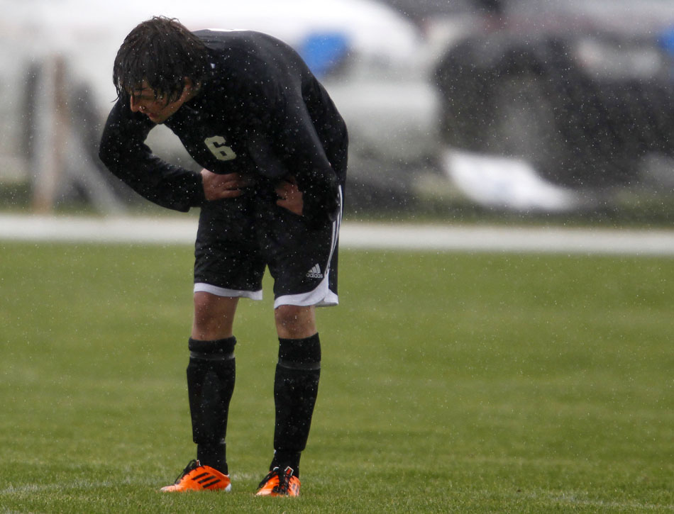 Cheyenne East's Clay Casey waits for the action to restart in the rain during a boy's state soccer quarterfinal on Thursday, May 19, 2011, in Sheridan, Wyo.