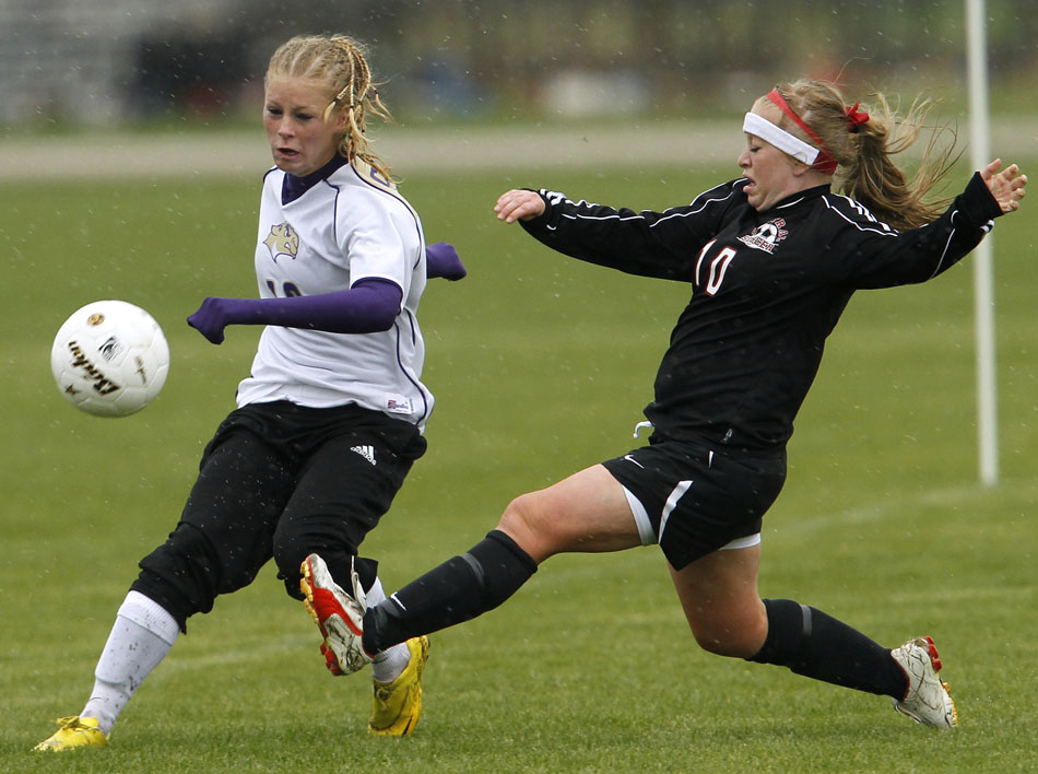 Cheyenne Central's Halee Moore (10) slides in to kick the ball away from Gillette's Madi Moore during a Class 4A girl's state soccer semifinal on Friday, May 20, 2011, in Sheridan, Wyo.