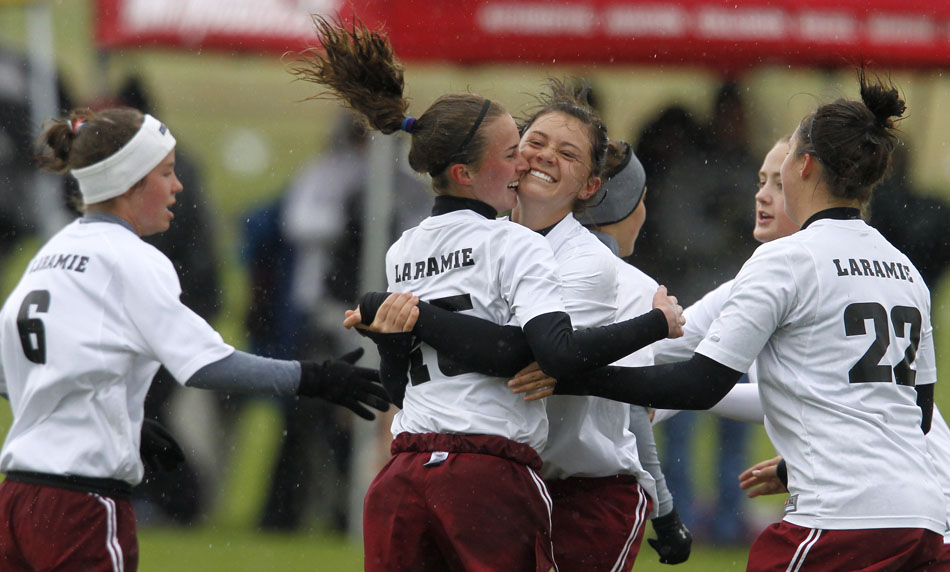 Laramie's Haley Moon celebrates with teammate Megan Dooley, back to camera, after Dooley scored a goal during a Class 4A girl's state soccer semifinal on Friday, May 20, 2011, in Sheridan, Wyo.