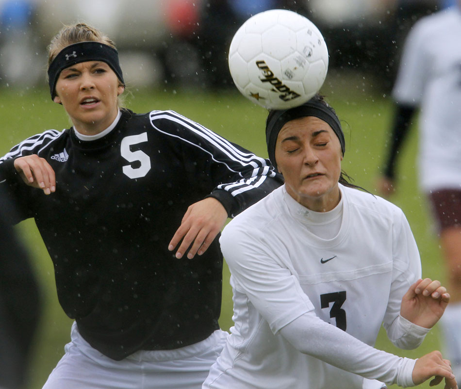Laramie's Lindsey Martinez (3) heads the ball away from Cheyenne East's Chelsea Crampton-Weber during a Class 4A girl's state soccer semifinal on Friday, May 20, 2011, in Sheridan, Wyo.