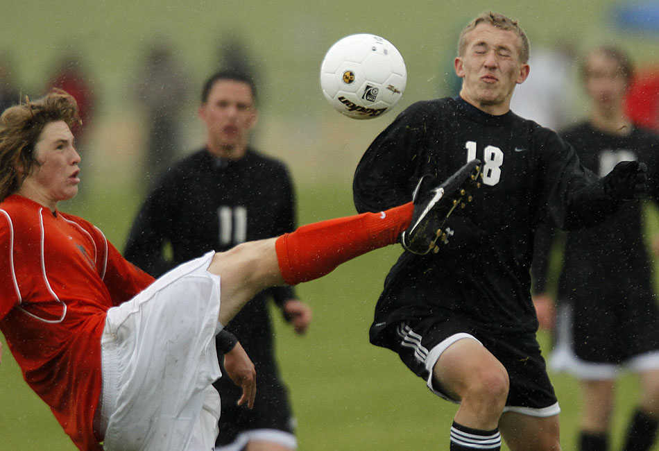 Rock Springs' Austin Lever, left, kicks the ball away from Cheyenne East's Ian Done (18) during a Class 4A boy's state soccer game on Friday, May 20, 2011, in Sheridan, Wyo.