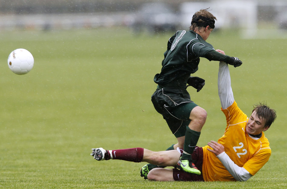 Kelly Walsh's Matt Binder (3) throws Laramie's Dillon Barbour to the pitch during a Class 4A boy's state soccer semifinal on Friday, May 20, 2011, in Sheridan, Wyo.