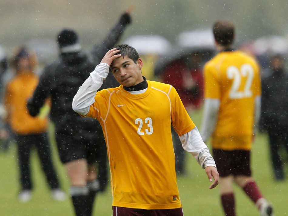 Laramie's Jimi Gomez reacts as an official issues a red card to teammate Andrew Johnson and coach Andy Pannell during a Class 4A boy's state soccer semifinal on Friday, May 20, 2011, in Sheridan, Wyo. Laramie played without its coach and down a player for most of the game, but came back to win 3-2.