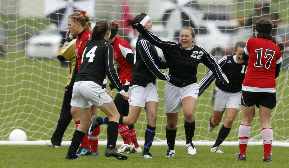 Cheyenne East's Brittney Rexius (22) celebrates with her teammates after she scored a goal against Cheyenne Central during a Class 4A girl's state soccer third place game on Saturday, May 21, 2011, in Sheridan, Wyo.
