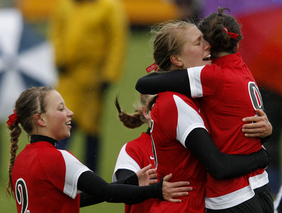 Cheyenne Central's Christie Schiel hugs teammate Makena Cameron after Cameron scored a goal during a Class 4A girl's state soccer third place game on Saturday, May 21, 2011, in Sheridan, Wyo.